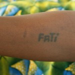A common tattoo of one's name on one's forearm